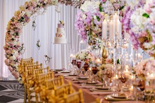 wedding-reception-spring-table-inspiration-gold-chairs-floating-cake-flower-arc-matching-centerpiece