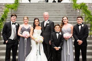 bride-and-groom-with-their-respective-sons-daughters-gray-dresses-charcoal-tuxedos-bouquets