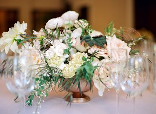 small-textured-centerpieces-with-variety-of-ivory-florals-and-greenery
