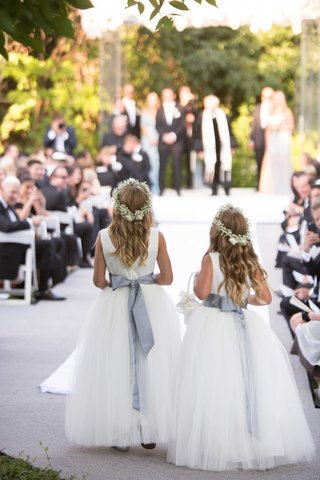 back-of-flower-girls-walking-down-aisle-with-grey-satin-ribbon-and-babys-breath-flower-crowns