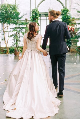 beauty-beast-movie-styled-wedding-shoot-back-of-gown-buttons-greenhouse-models-long-man-bun