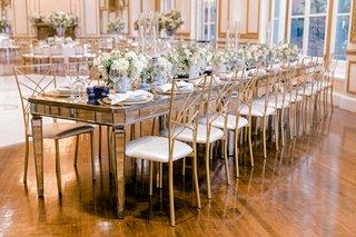 wedding-reception-ballroom-mirror-head-table-blue-white-candlestick-and-soft-white-green-centerpiece