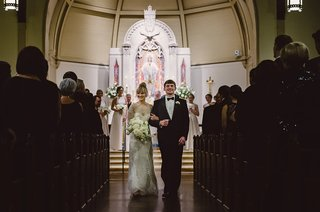 bride-and-groom-monique-lhuillier-wedding-dress-walk-up-aisle-at-church-in-north-carolina