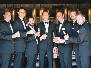 groom-and-groomsmen-with-tuxedos-pocket-squares-modelo-miller-lite-bow-tie-corona-stella-artois