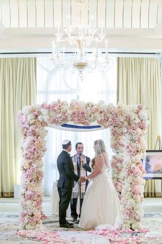 wedding-ceremony-ballroom-blush-and-white-rose-flower-chuppah-chandelier-casa-del-mar