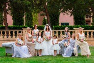 bride-in-kleinfeld-wedding-dress-with-bridesmaids-mismatch-dresses-and-flower-girls-flower-crown