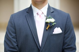 grooms-boutonniere-with-white-flower-and-thistle-plants-grey-suit-light-pink-tie