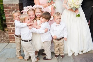 ring-bearers-in-khaki-pants-and-white-shirts-and-flower-girls