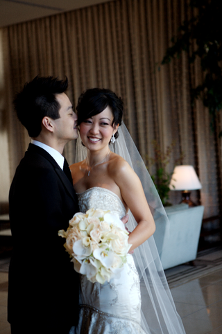 bride-in-a-beaded-lazaro-gown-and-groom-in-a-black-tuxedo