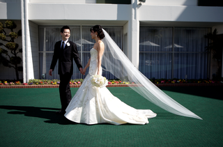 bride-in-a-fit-and-flare-lazaro-gown-and-veil-with-groom-in-a-black-tuxedo-on-the-dance-floor