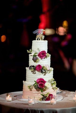 wedding-cake-with-buttercream-frosting-pink-flower-white-ranunculus-giraffe-cake-topper-with-veil