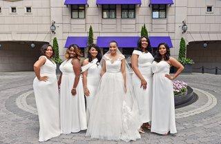 bride-in-legends-romona-keveza-a-line-wedding-dress-and-illusion-neckline-bridesmaids-in-white