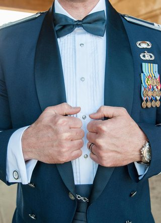 groom-in-bow-tie-and-formal-officer-military-uniform