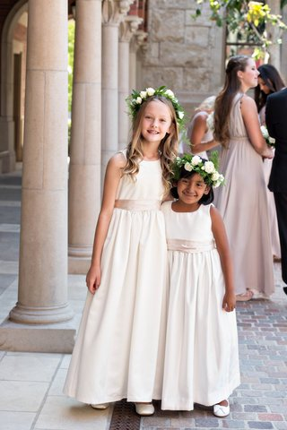 two-flower-girls-with-long-ivory-dresses-and-taupe-sashes-flower-crowns