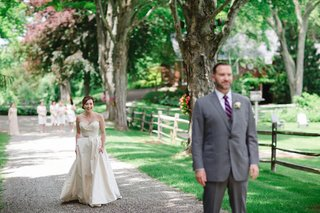 bride-in-romona-keveza-legends-collection-l267-groom-in-brooks-brothers-first-look