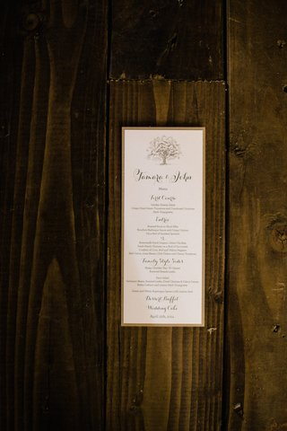 white-menu-card-with-tan-border-on-wood-planks