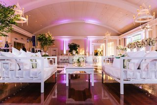 wood-floor-ballroom-at-wedding-reception-white-lounge-furniture-daybed-couch-white-coffee-table