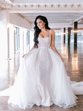 bride-with-long-black-hair-soft-hollywood-waves-sparkle-form-fitting-gown-tulle-overskirt-train