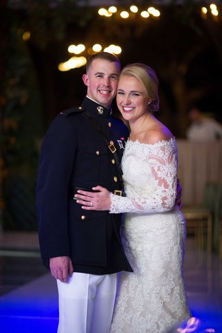 bride-in-off-the-shoulder-long-sleeve-isabelle-armstrong-wedding-dress-with-military-groom