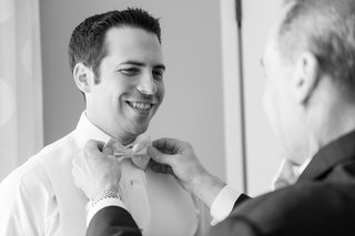 black-and-white-photo-of-father-adjusting-grooms-bow-tie-wedding-best-man-florida