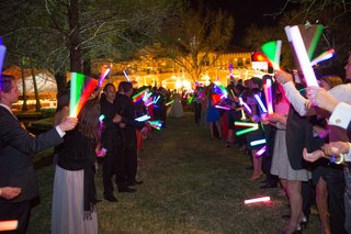 wedding-guests-holding-light-sticks-outside