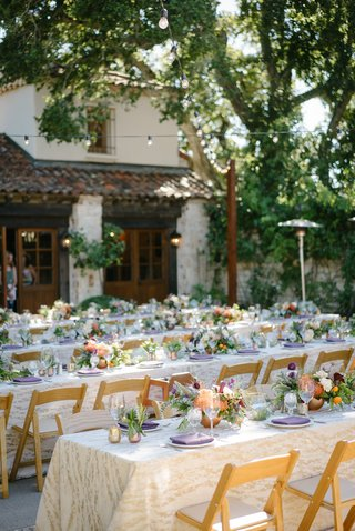 long-family-style-tables-with-ivory-and-gold-patterned-linens-low-centerpieces