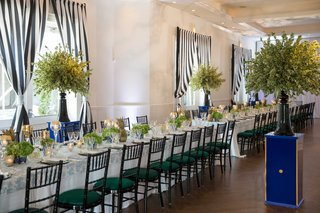 green-cushioned-seating-blue-and-white-decor-long-table-curtains-stripes-pattern