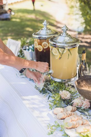 guest-pouring-glass-of-lavender-lemonade-out-of-drink-dispenser