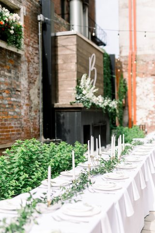 long-kings-table-with-italian-ruscus-garland-through-tapered-candles