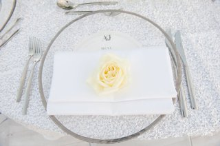 ivory-rose-on-white-napkin-clear-charger-with-chrome-rim-silver-glitter-linens