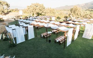 pitch-perfect-stars-anna-camp-skylar-astin-wedding-outdoor-reception-tented-drapes-structures-tables