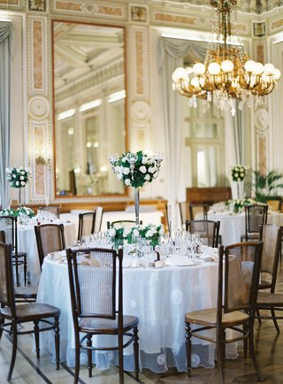 wedding-reception-high-low-centerpiece-greenery-white-flowers-candelabra-vintage-inspired-design