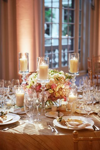 wedding-reception-at-the-breakers-with-low-centerpiece-rose-lisianthus-berry-candles-and-berries