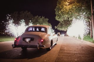 vintage-car-exit-with-fireworks