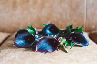 dark-purple-red-burgundy-flower-calla-lily-boutonnieres-on-seat-wedding-ideas