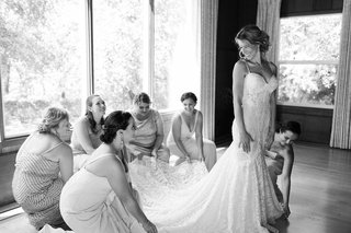 black-and-white-photo-bridesmaids-helping-bride-berta-wedding-dress-ready
