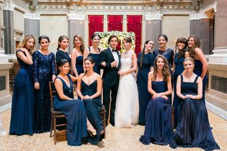 bridesmaids-with-couple-wearing-navy-blue-bridesmaid-dresses