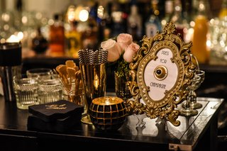 gold-and-black-decor-wedding-bar-intricate-gold-frame-with-bell-for-champagne