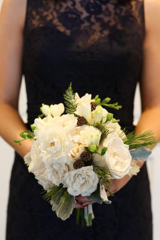 winter-wedding-bouquet-with-white-flowers-pinecones-and-evergreen-foliage