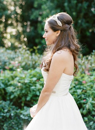 bride-profile-silhouette-in-strapless-reem-acra-wedding-dress-hair-down-jenny-packham-hair-accessory