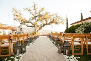 burlap-aisle-runner-with-moroccan-lanterns-at-rustic-ceremony
