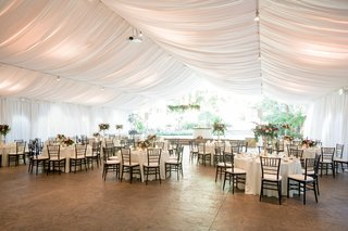 tented-reception-with-draped-ceiling-with-open-garden-space