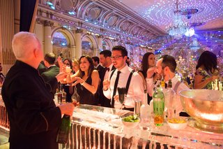 guests-order-drinks-at-ice-bar-at-wedding-reception-in-the-plaza