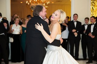 bride-in-strapless-ball-gown-from-kleinfeld-bridal-with-updo-blonde-hair-dancing-with-father