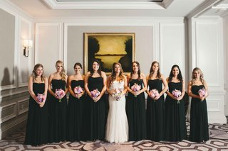 bride-in-monique-lhuillier-intrigue-bridesmaids-in-black-strapless-dresses