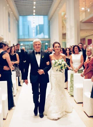 bride-in-vera-wang-gown-walks-down-aisle-with-her-father-of-bride-in-tuxedo-and-bow-tie