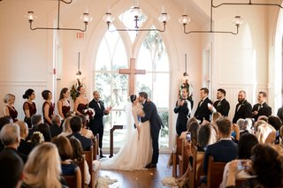bride-and-groom-kiss-at-church-chapel-wedding-montage-palmetto-bluff-in-south-carolina-bridesmaids