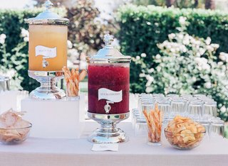 drink-dispensers-filled-with-orange-and-red-tea-at-cocktail-hour