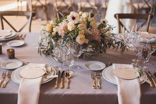 lavender-wedding-table-with-round-wood-menus-low-flower-arrangements-anemone-dahlia-garden-rose