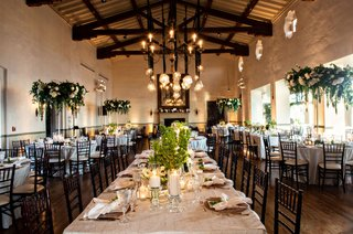 wedding-reception-bel-air-bay-club-fireplace-reception-room-wood-beams-chandelier-pendant-greenery